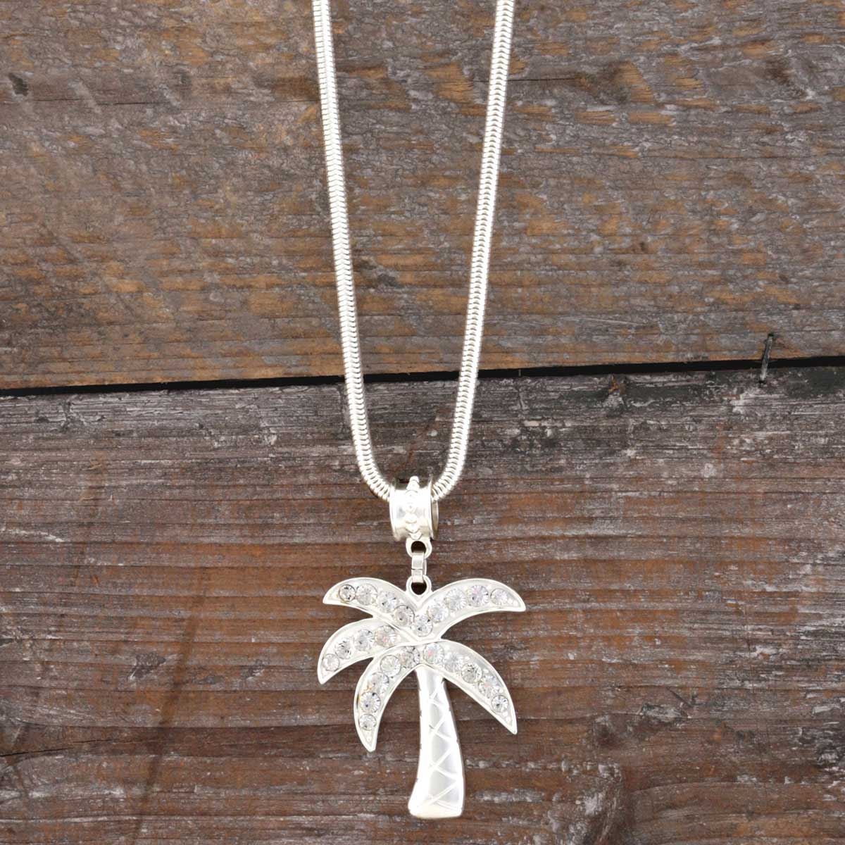 "MATTE SILVER PALM TREE NECKLACE 1.875""X2.25"" WITH CRYSTALS"
